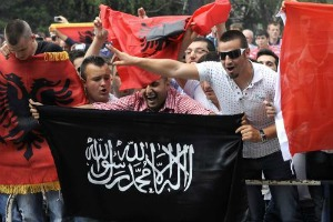 Islamic and Albanian flags at protest